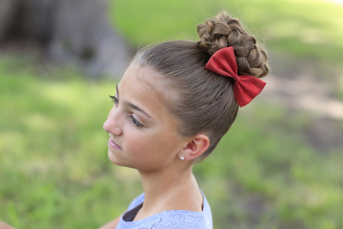 "Young girl outside modeling ""Bun of Braids"" hairstyles"