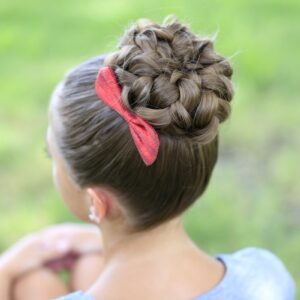"""Young girl sitting outside modeling """"Pancaked Bun of Braids"""" hairstyle"""