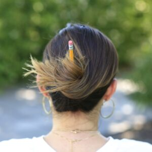 Woman outside modeling Pencil Messy Buns | Back-to-School Hairstyles