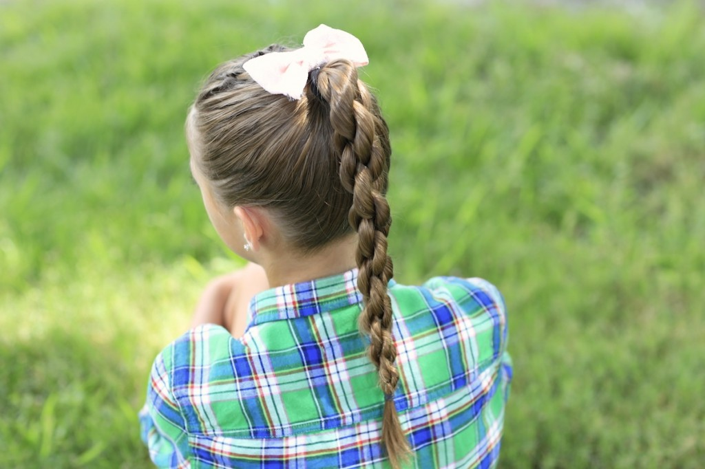 Little girl outside modeling Chain Link Braid