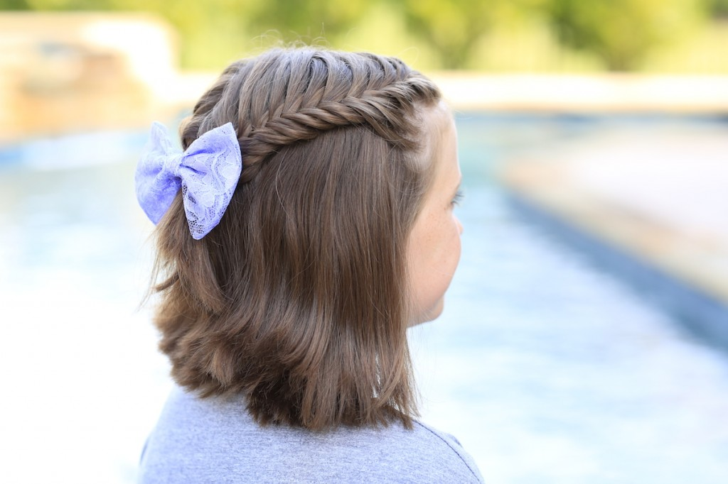 Little girl sitting by the pool modeling Laced Fishtail Tieback