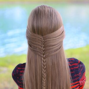 Young girl outside modeling Mermaid Half Braid | Hairstyles for Long Hair