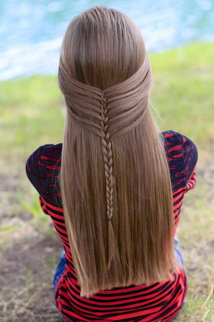 Young girl outside modeling Mermaid Half Braid | Hairstyles for Long Hair (back)