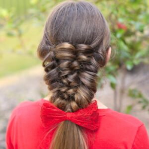 Young girl wearing a red shirt modeling Banded Puff Braid