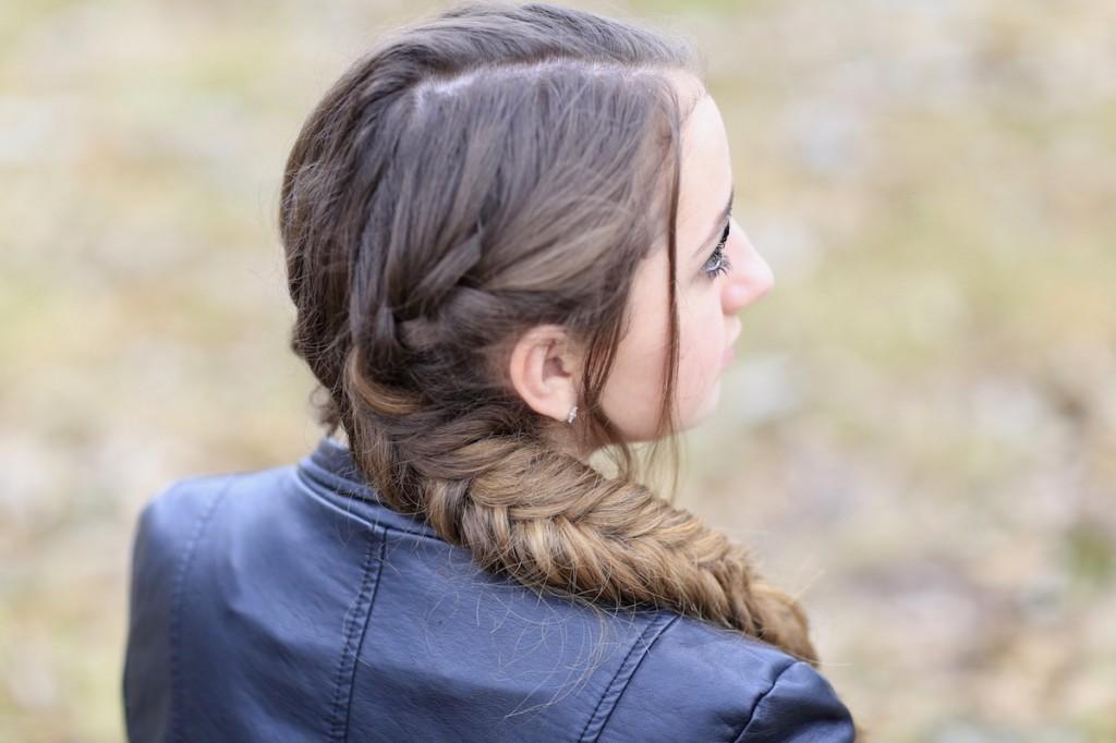 Girl outside wearing a back jacket modeling Katniss' Mockingjay Braid | Hunger Games Hairstyles