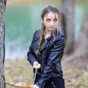 Girl outside wearing a back jacket modeling Katniss' Mockingjay Braid | Hunger Games Hairstyles