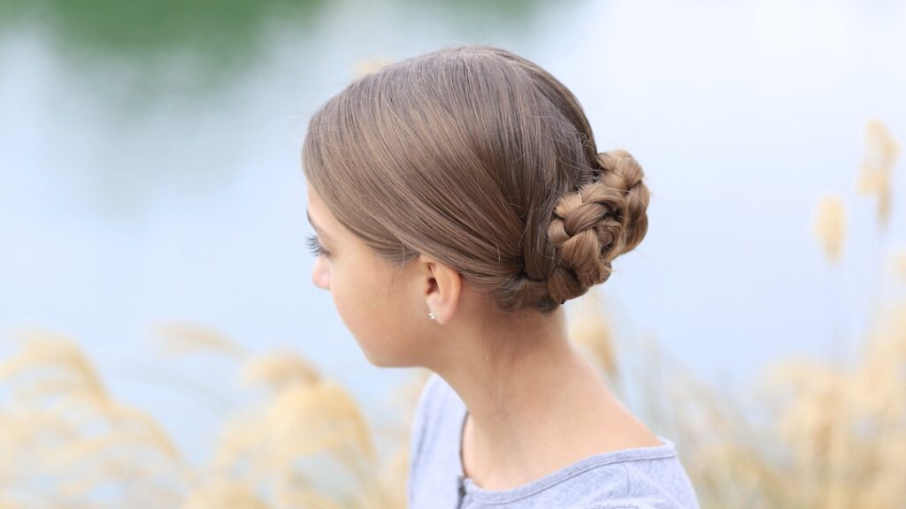 Young girl outside modeling Prim's Braided Updo | Hunger Games Hairstyles