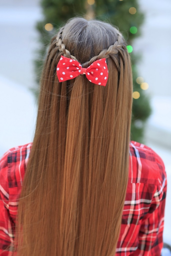 Young girl outside modeling Upward Lace Braid (back)