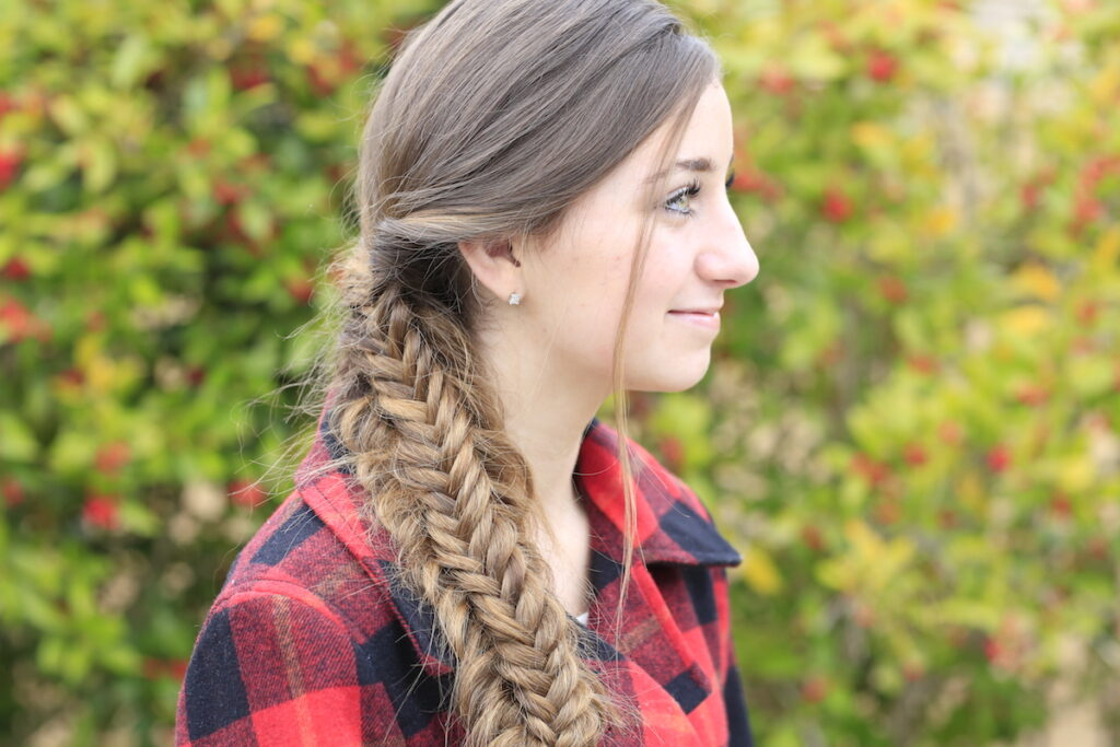 Young girl outside modeling Messy Split Fishtail Braid
