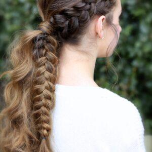 Young girl outside wearing a white shirt modeling Viking Braid Ponytail   Ponytail Ideas