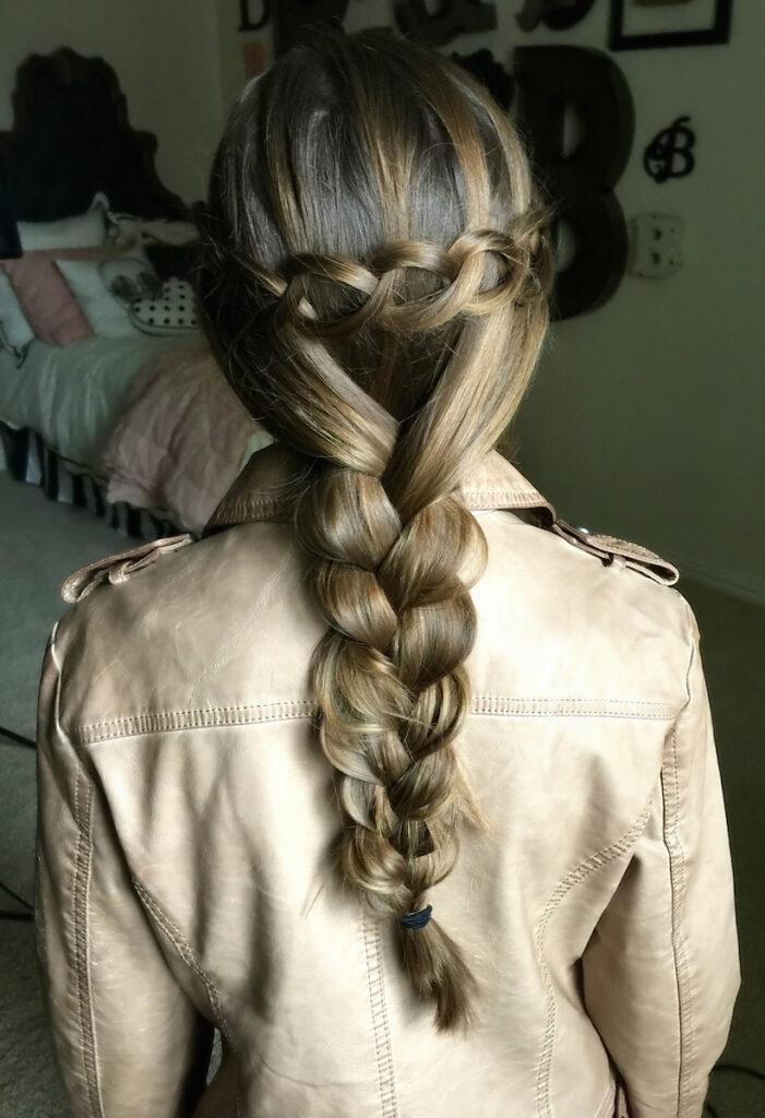 Young girl in her room modeling Loop Waterfall Braid
