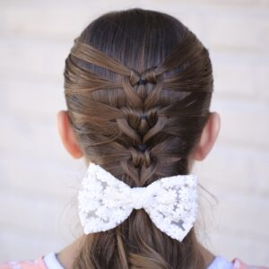 Young girl standing outside modeling Mermaid Heart Braid | Cute Valentine's Day Hairstyles (Back)
