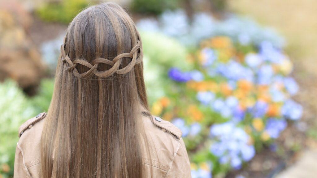 Young girl outside modeling Loop Waterfall Braid