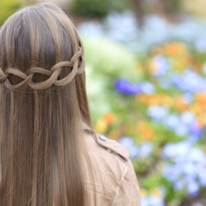 Young girl outside modeling Loop Waterfall Braid
