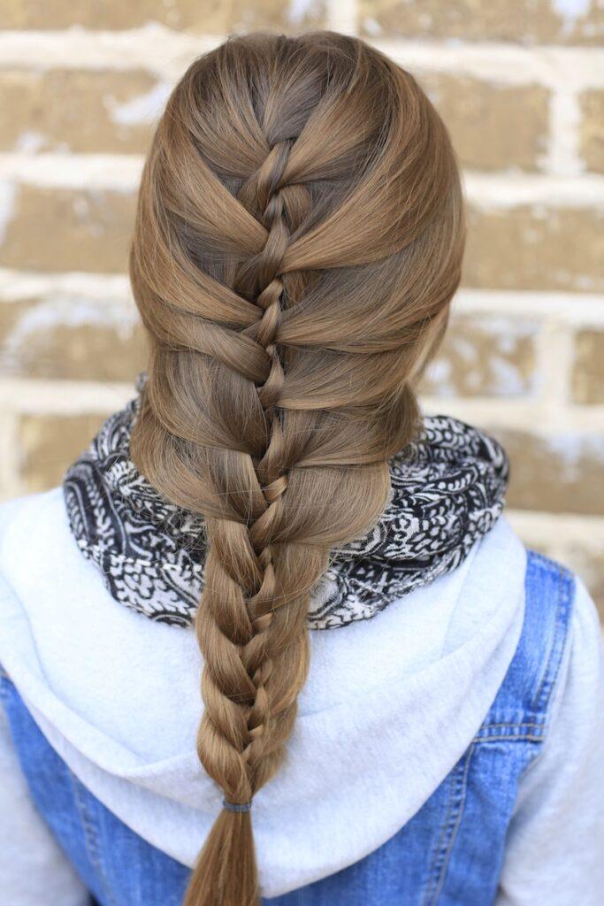 Young girl outside modeling Waterfall Twist & Mermaid Braid Combo (back)