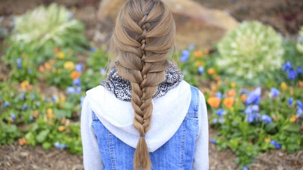 Young girl outside modeling Waterfall Twist & Mermaid Braid Combo