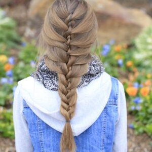 Young girl outside modeling Waterfall Twist & Mermaid Braid Combo