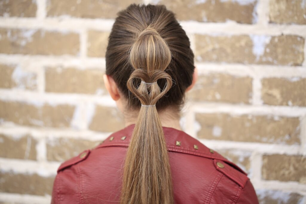 Young girl standing outside modeling Heart Ponytail | Valentine's Day Hairstyles