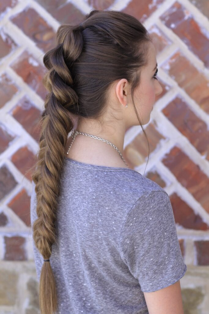 Young girl outside modeling the Pull-Through Fishtail Braid Combo