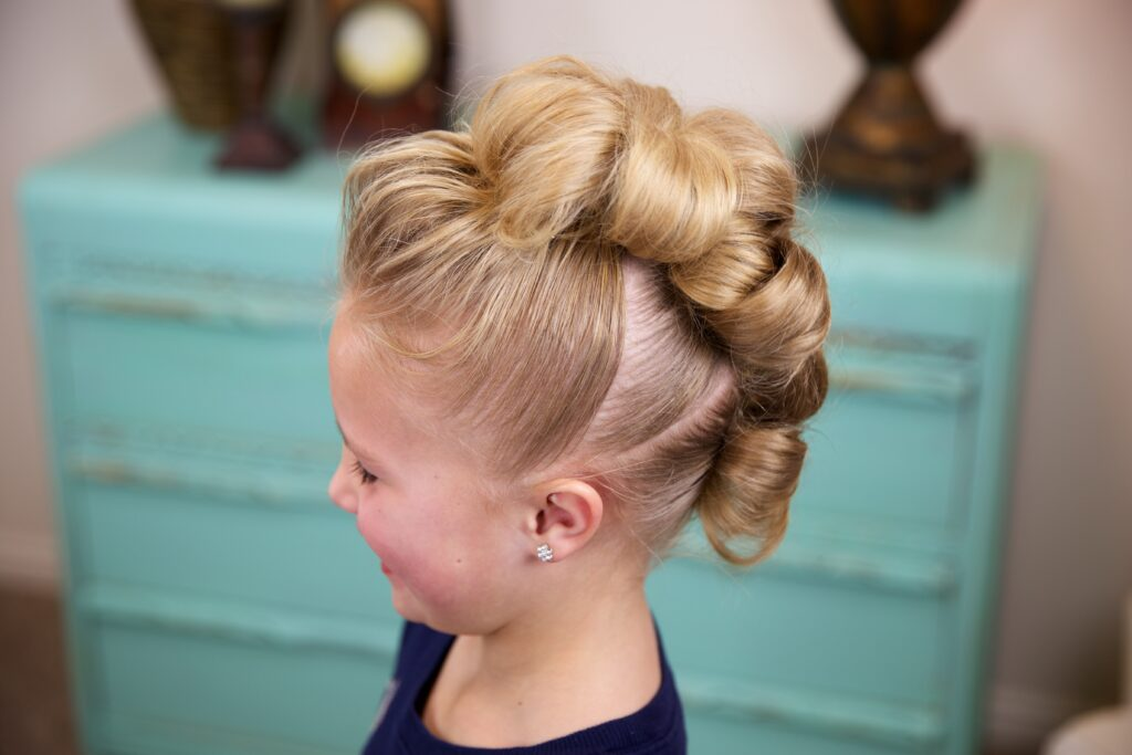 Little girl indoors Flower Bun Hawk | Hairstyles for Dance