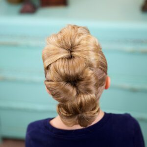 Little girl indoors Flower Bun Hawk | Hairstyles for Dance (Back)