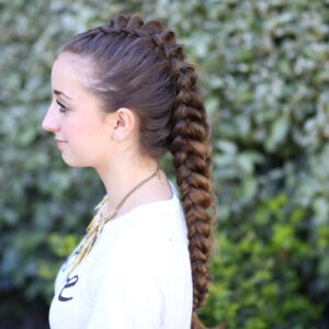 Young girl standing outside modeling Dragon Braid | Hairstyles for Girls