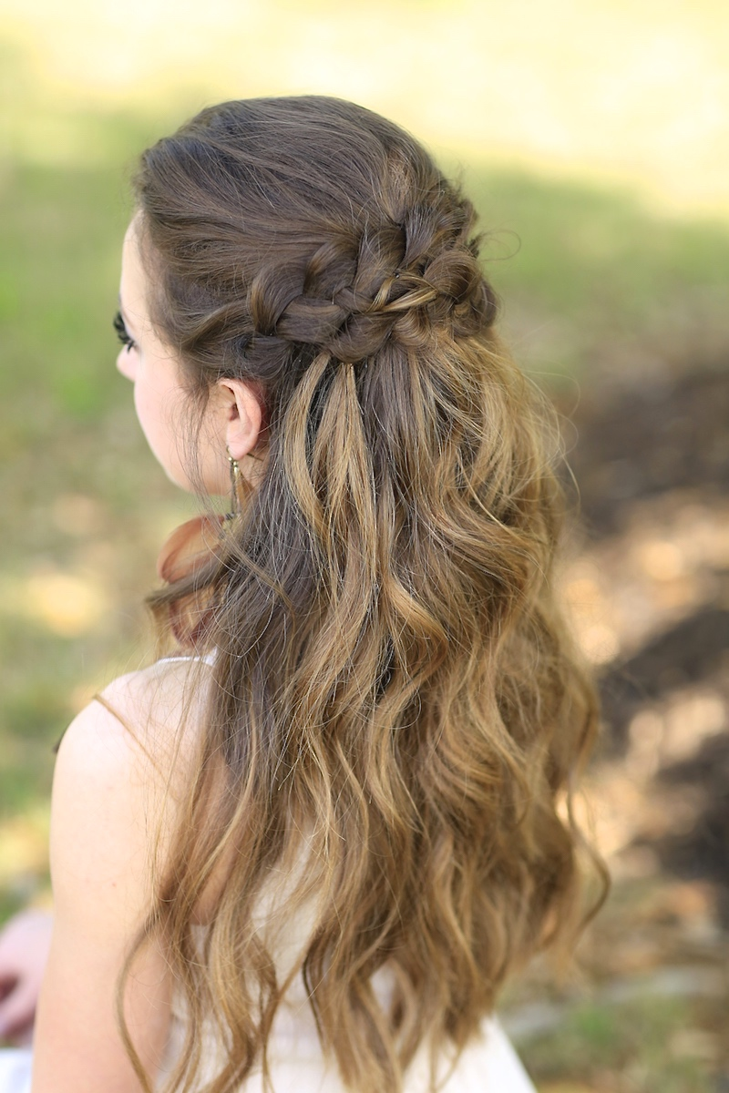 "Back view of girl with long hair standing outside modeling ""Braided Half Up"""