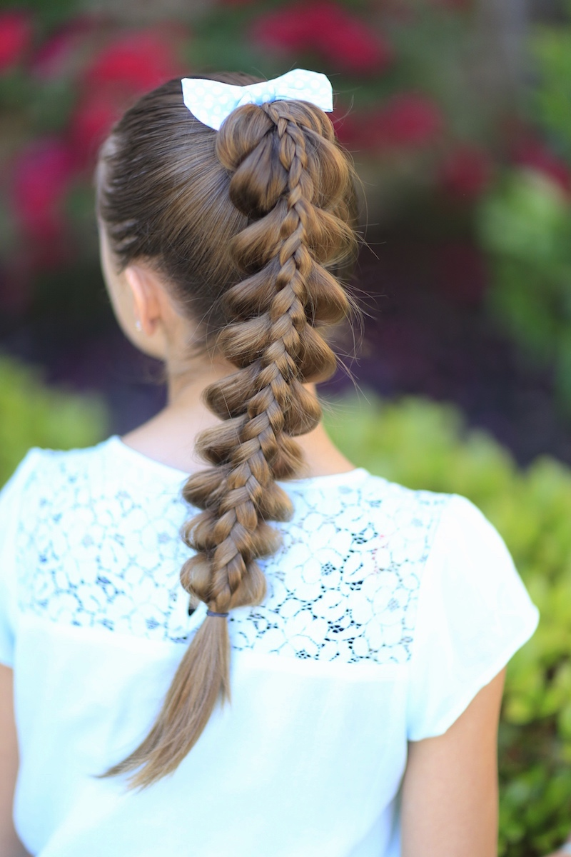 Young girl outside modeling Stacked Pull-Through Braid