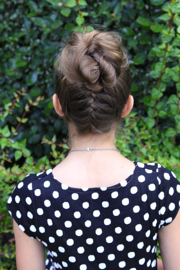 Young girl outside modeling Double-French Messy Bun Updo (Back)