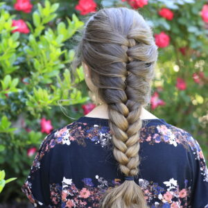 Young girl outside modeling Faux French Braid (Back)