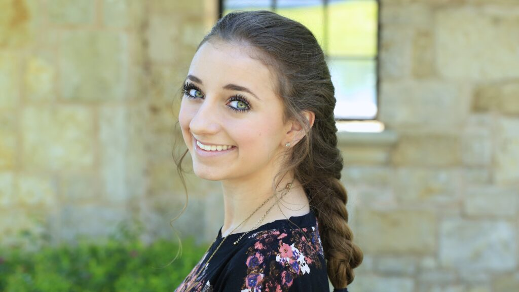 Young girl outside modeling Faux French Braid