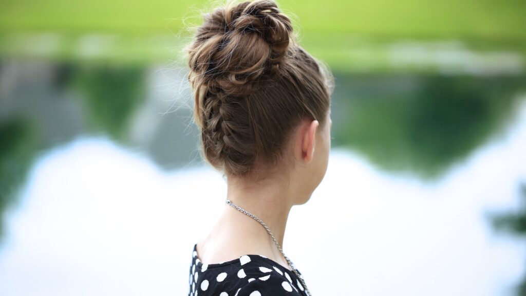 Young girl outside modeling Double-French Messy Bun Updo