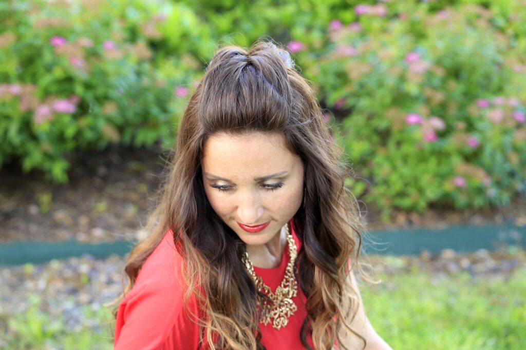 Woman outside with a red shirt modeling Woven Faux Hawk | Edgy Hairstyles
