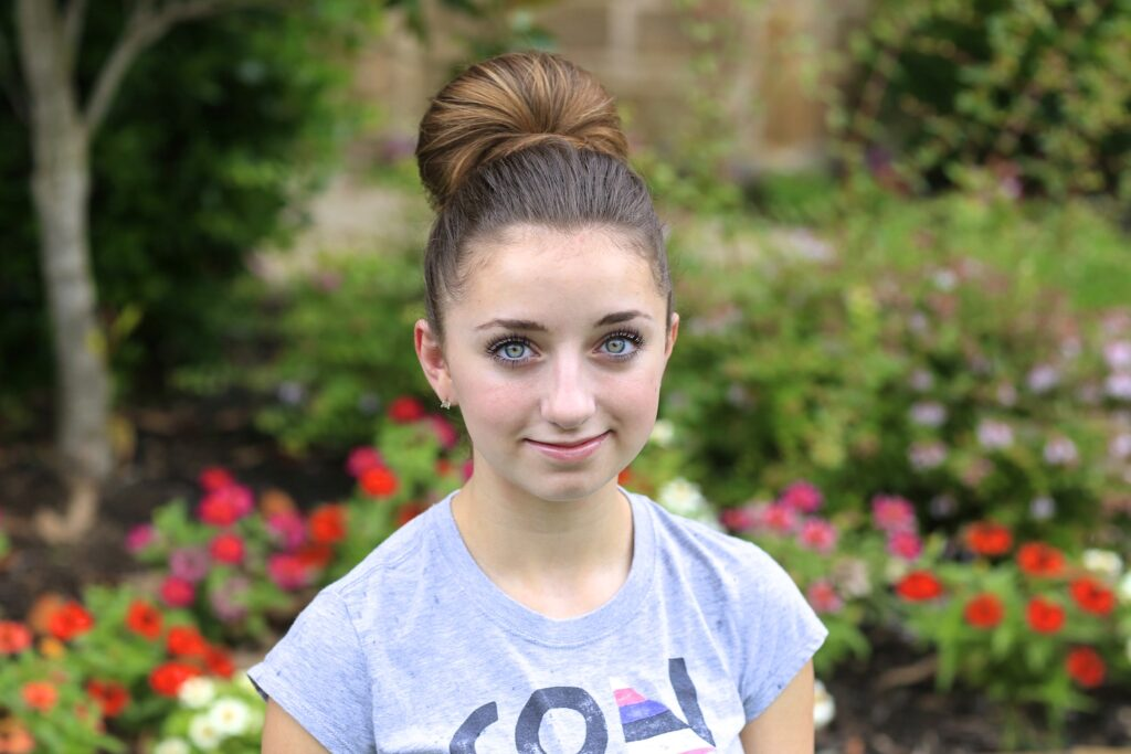 Portrait of a young girl modeling The Fan Bun | Prom Updos