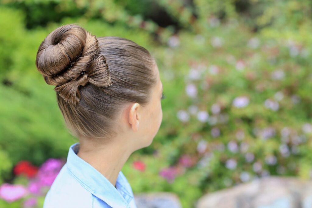 Young girl outside modeling Bow Bun Updo
