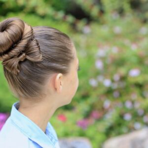 Young girl outside modeling Bow Bun Updo (Back)