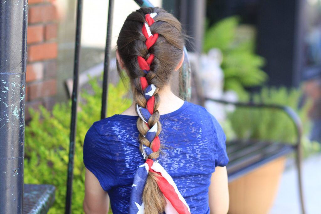 Young girl outside modeling 3-Minute Scarf Braid | 4th of July Hairstyles (Back)