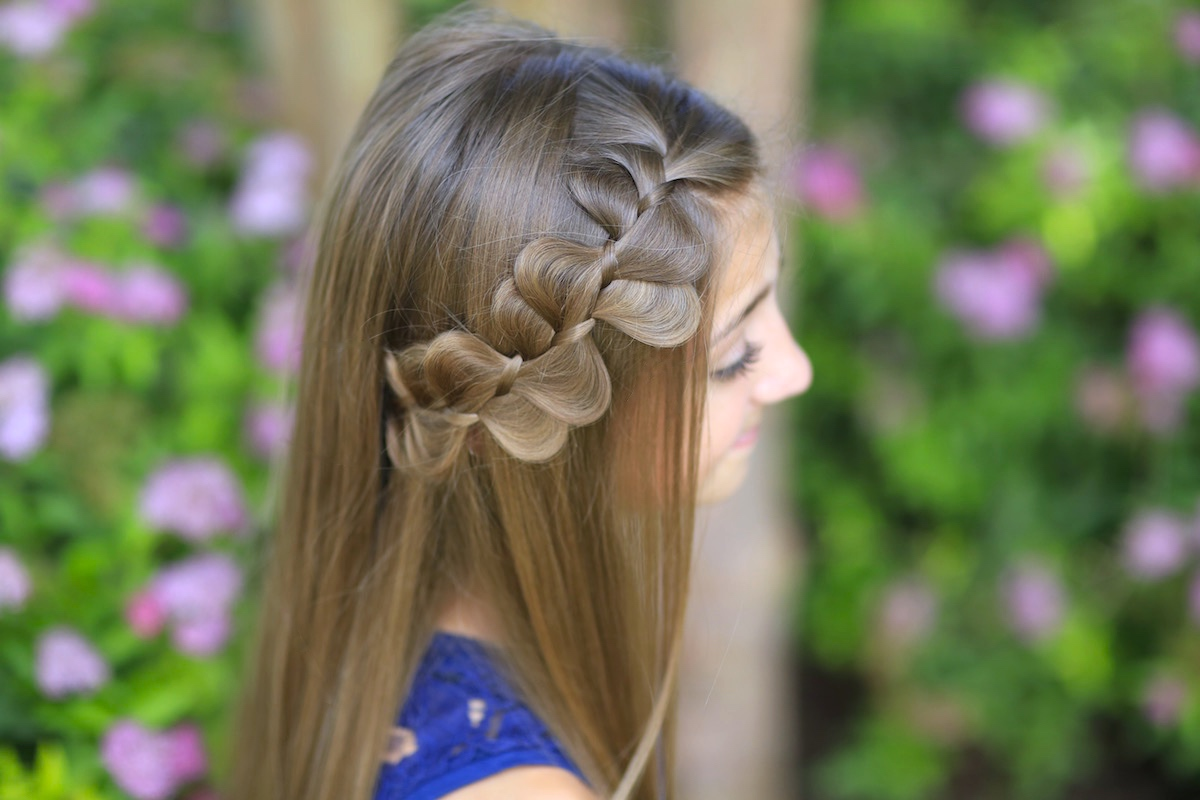 Young girl outside modeling Rick Rack Braid
