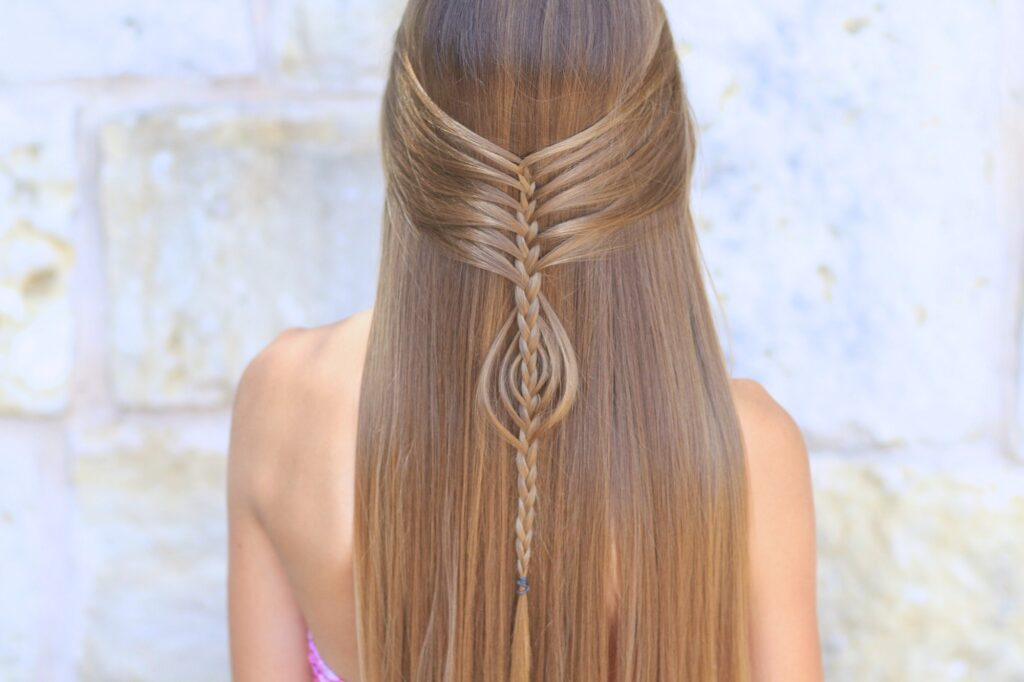 Young girl outside modeling Mermaid Braid Combo