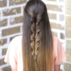 Young girl with long hair modeling Bubble Fishtail Braid