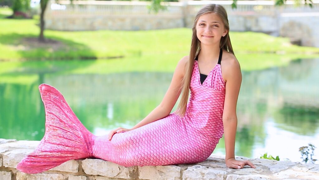Young girl dressed up in a mermaid costume modeling Mermaid Braid Combo