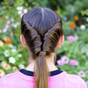 Young girls outside modeling Tornado Twist hairstyle (back)