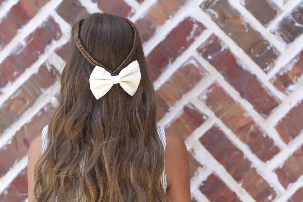 Young girl outside modeling Infinity Braid Tieback | Back-to-School Hairstyles (Back)