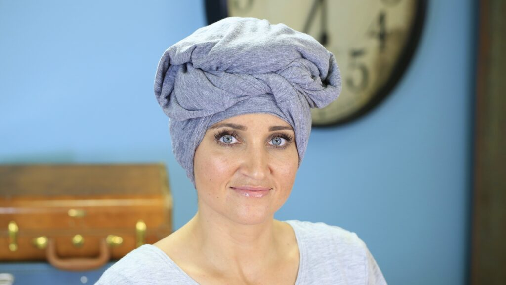 Portrait of woman with her hair wrap in a towel
