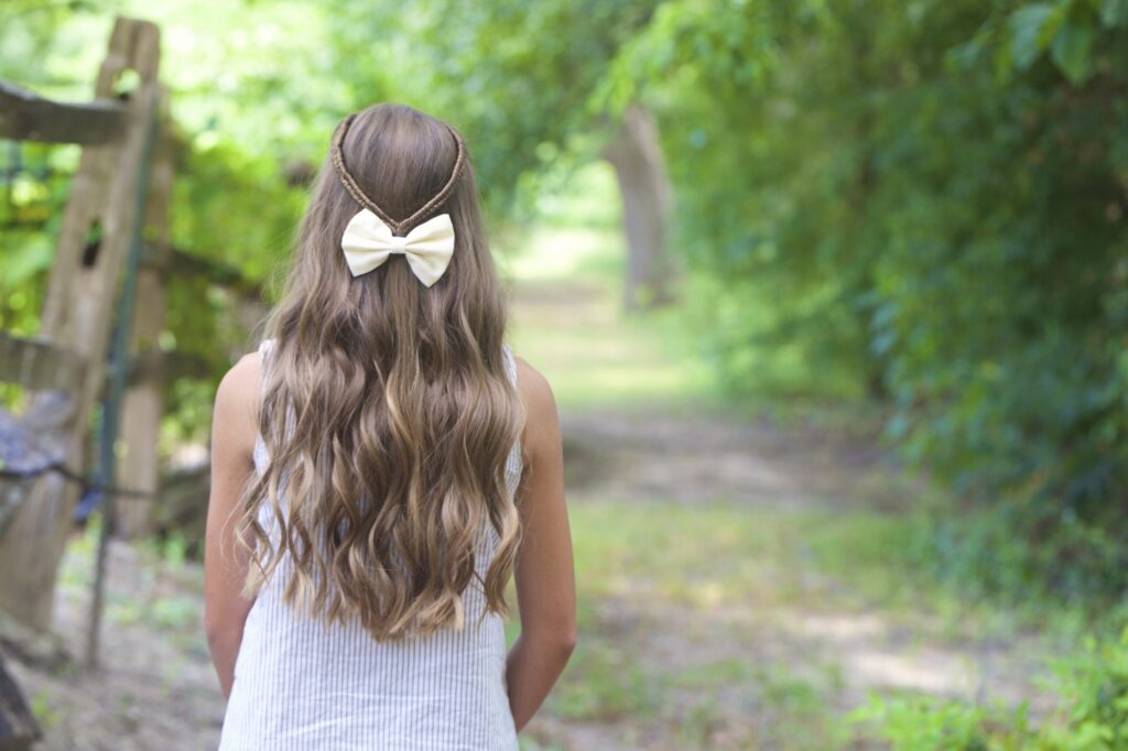 Young girl outside modeling Infinity Braid Tieback | Back-to-School Hairstyles