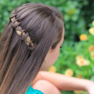 Young girl modeling Knotted Waterfall Braid