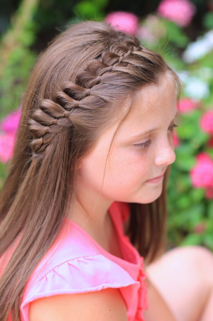Young girl outside modeling 4-Strand French Braid | Easy Hairstyles