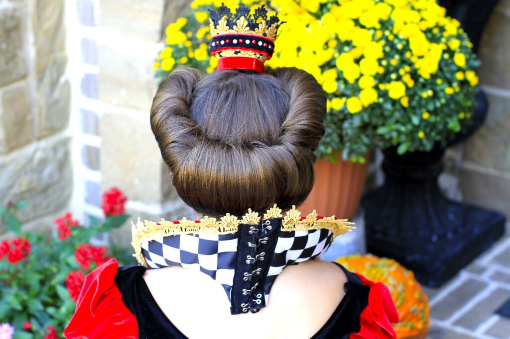 Young girl dressed up as the Queen of Hearts | Halloween Hairstyle (Back)