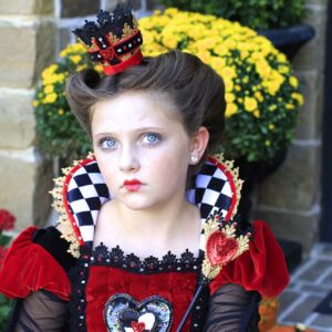 young girl dressed up as the Queen of Hearts |Halloween Hairstyle