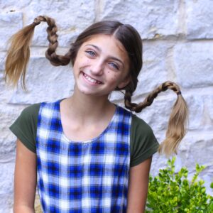 young girl modeling Pippi Longstocking Braids